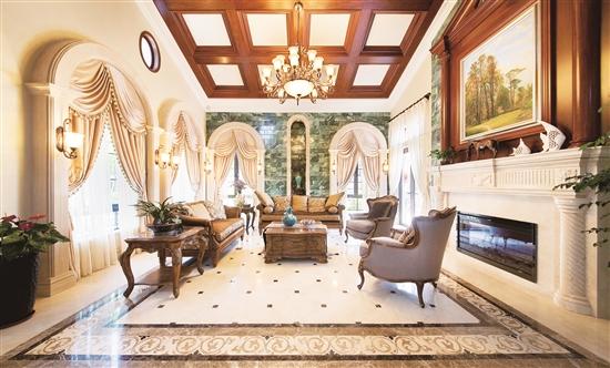 客厅地面采用朴素的石材拼花,吊顶设计原木假梁与其相互呼应,较大程